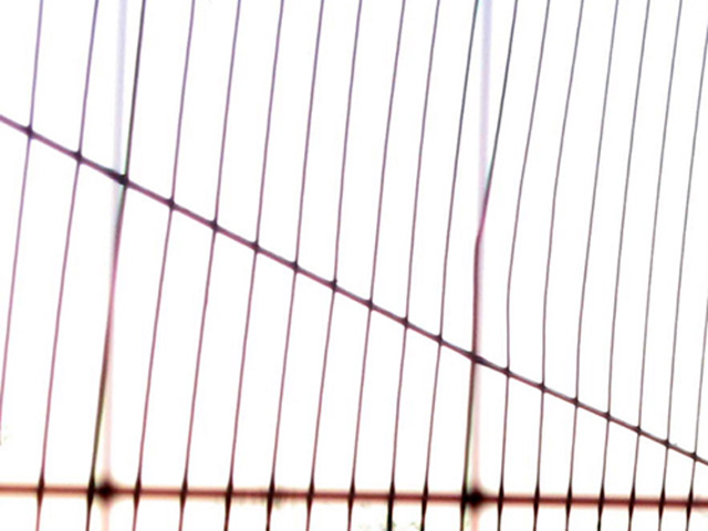 air through a metal fence